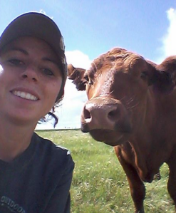 Hollyn and her Red Angus cow.